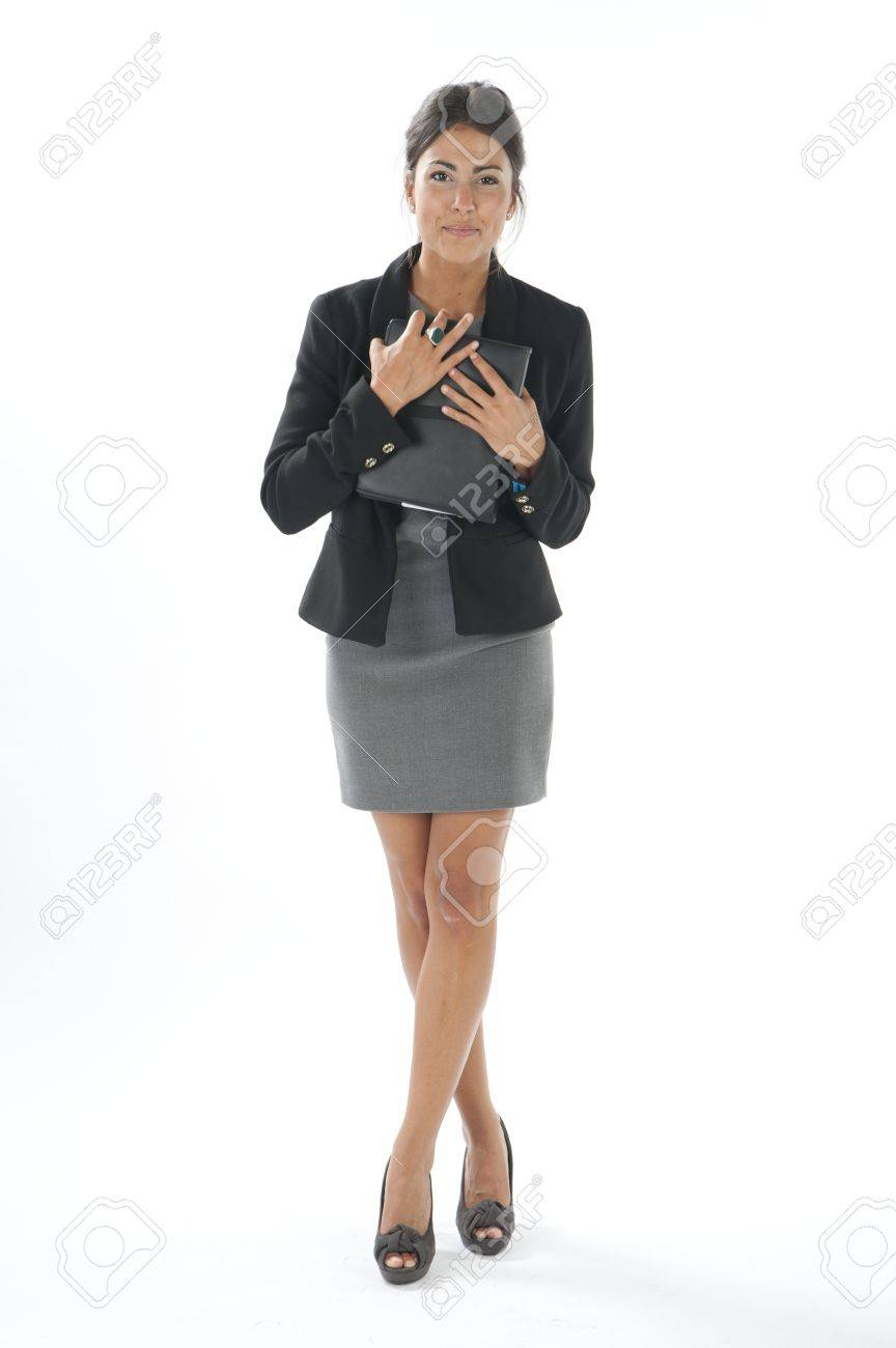 Self confident female young business executive holding notebook in her hands looking at camera. Stock Photo - 14429479