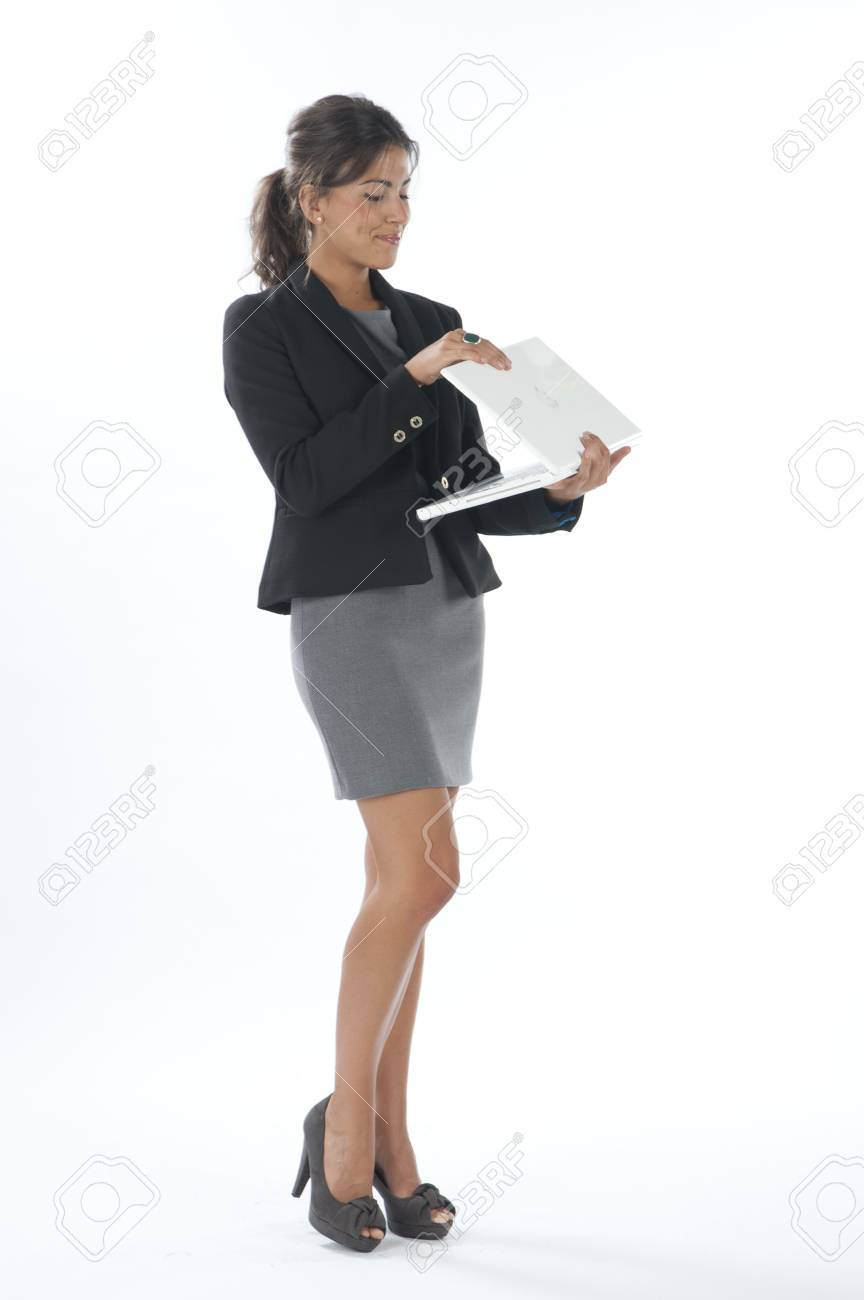 Female young business executive looking at laptop. Stock Photo - 14429495