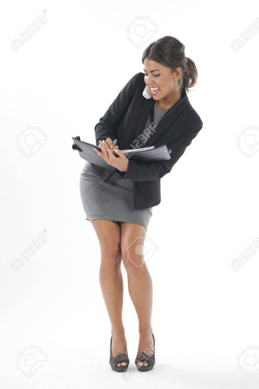 Bussy young executive female, talking on the phone and writing on her notebook. Stock Photo - 14429577