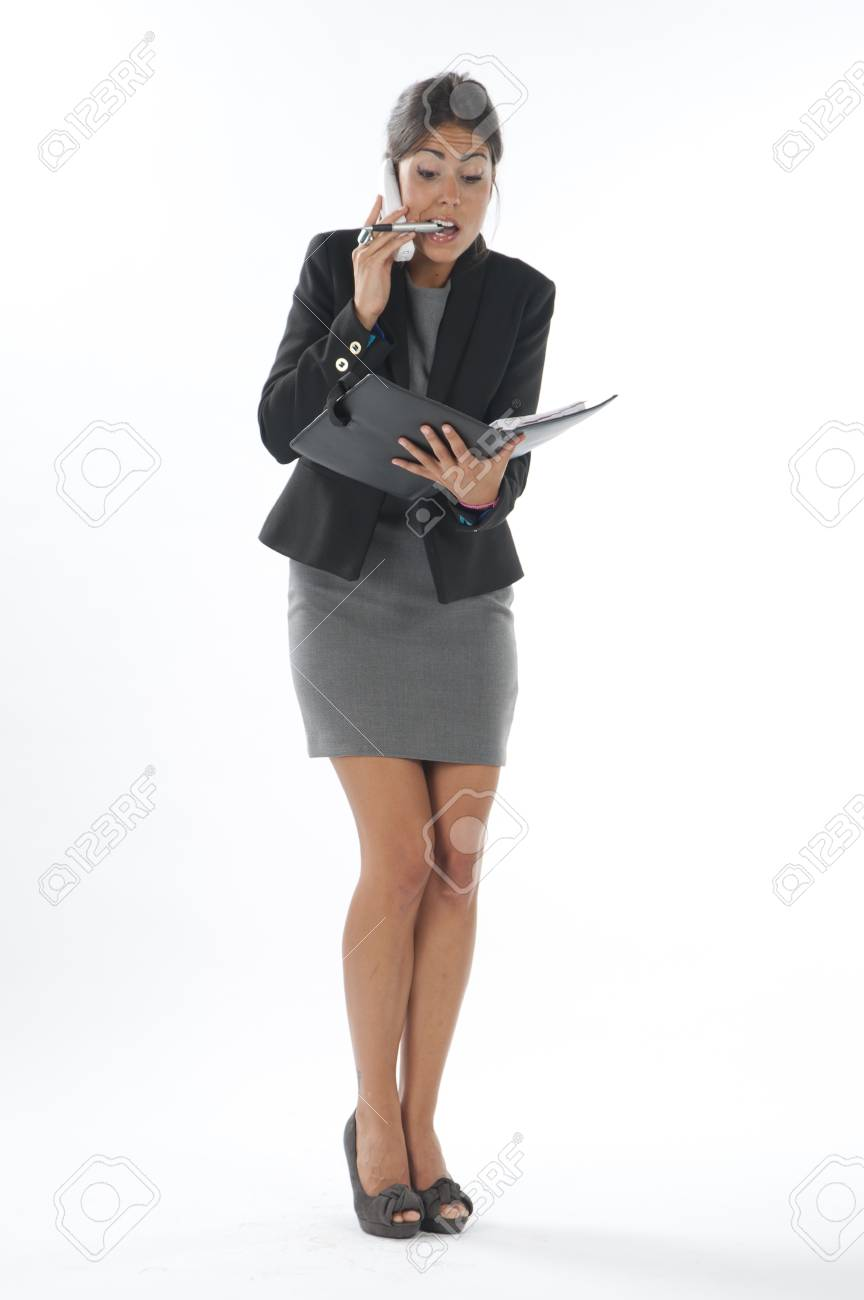 Bussy young executive female, talking on the phone and writing on her notebook. Stock Photo - 14429701
