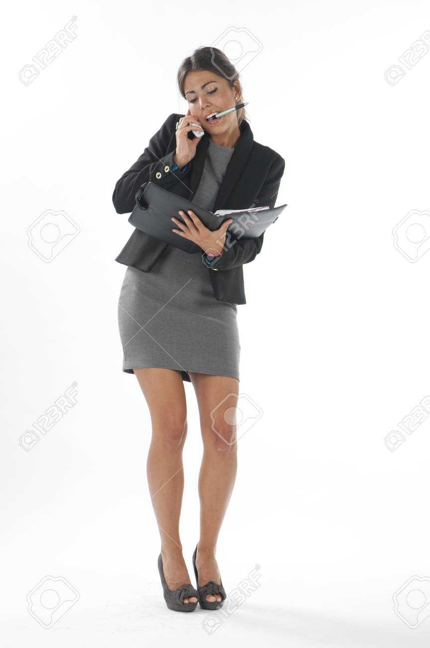 Bussy young executive female, talking on the phone and writing on her notebook. Stock Photo - 14429734