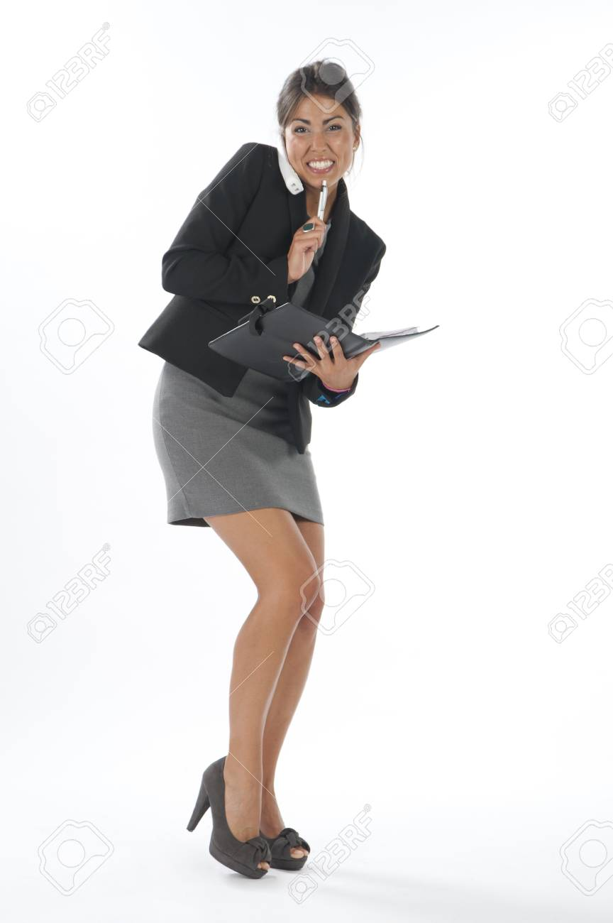 Bussy young executive female, talking on the phone and writing on her notebook. Stock Photo - 14429635