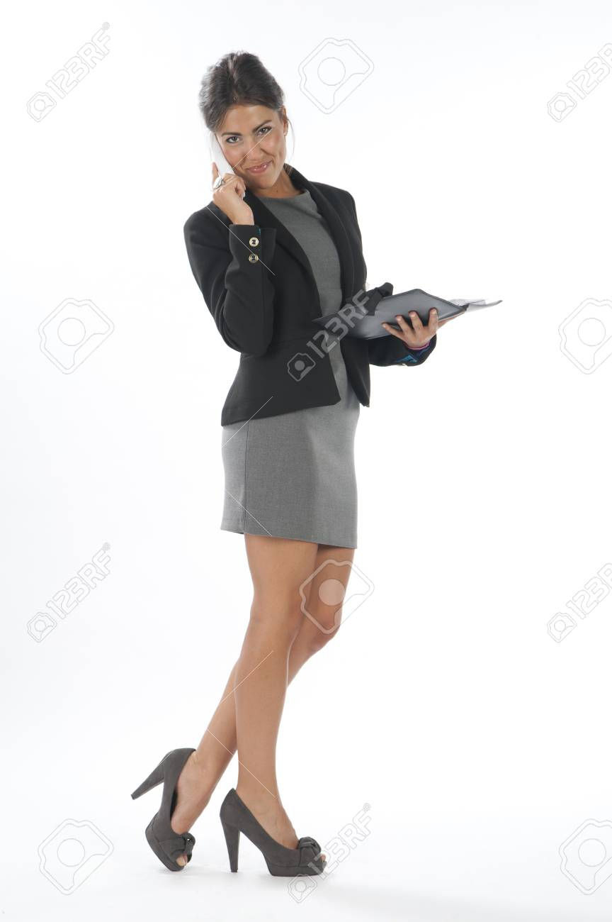 Young business executive female, on white, talking on the phone, looking at camera. Stock Photo - 14429656