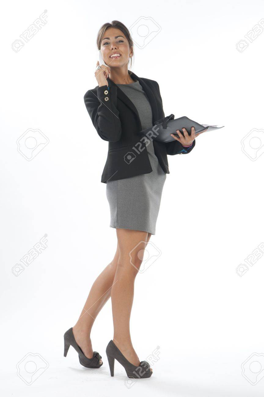 Young business executive female, on white, talking on the phone, looking at camera. Stock Photo - 14429584