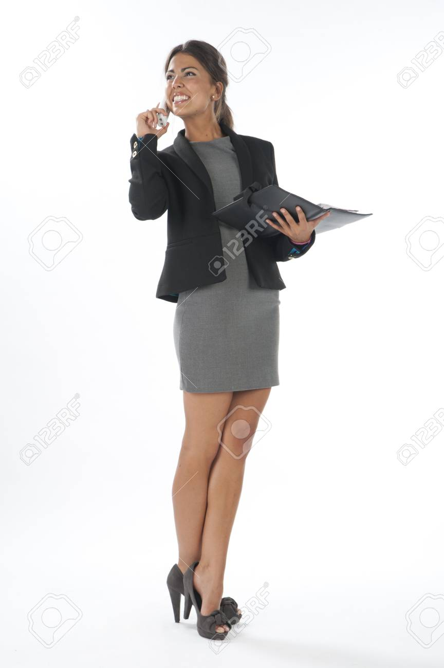 Young business executive female, on white, talking on the phone, looking away. Stock Photo - 14429714