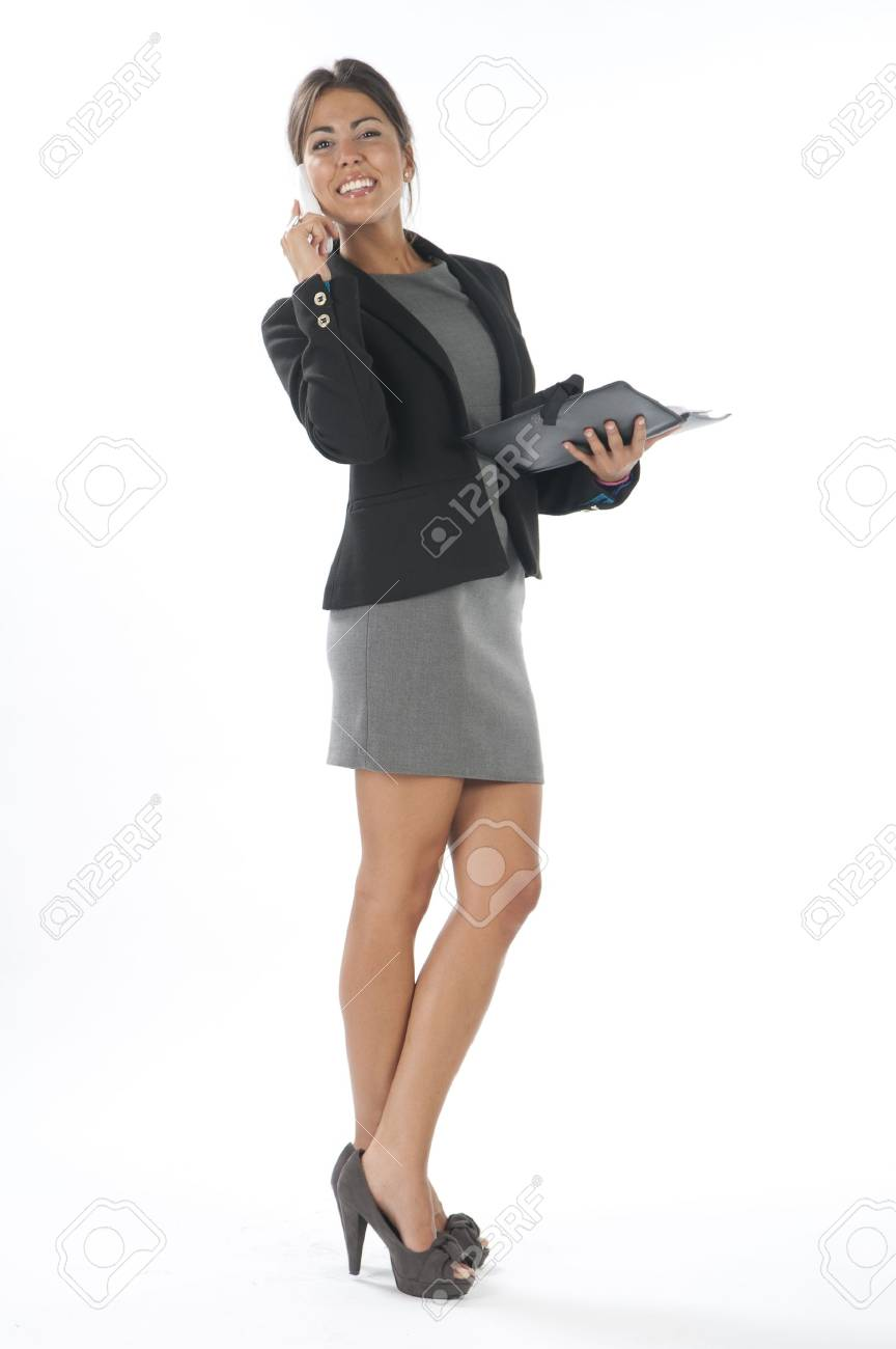 Young business executive female, on white, talking on the phone, looking away. Stock Photo - 14429502