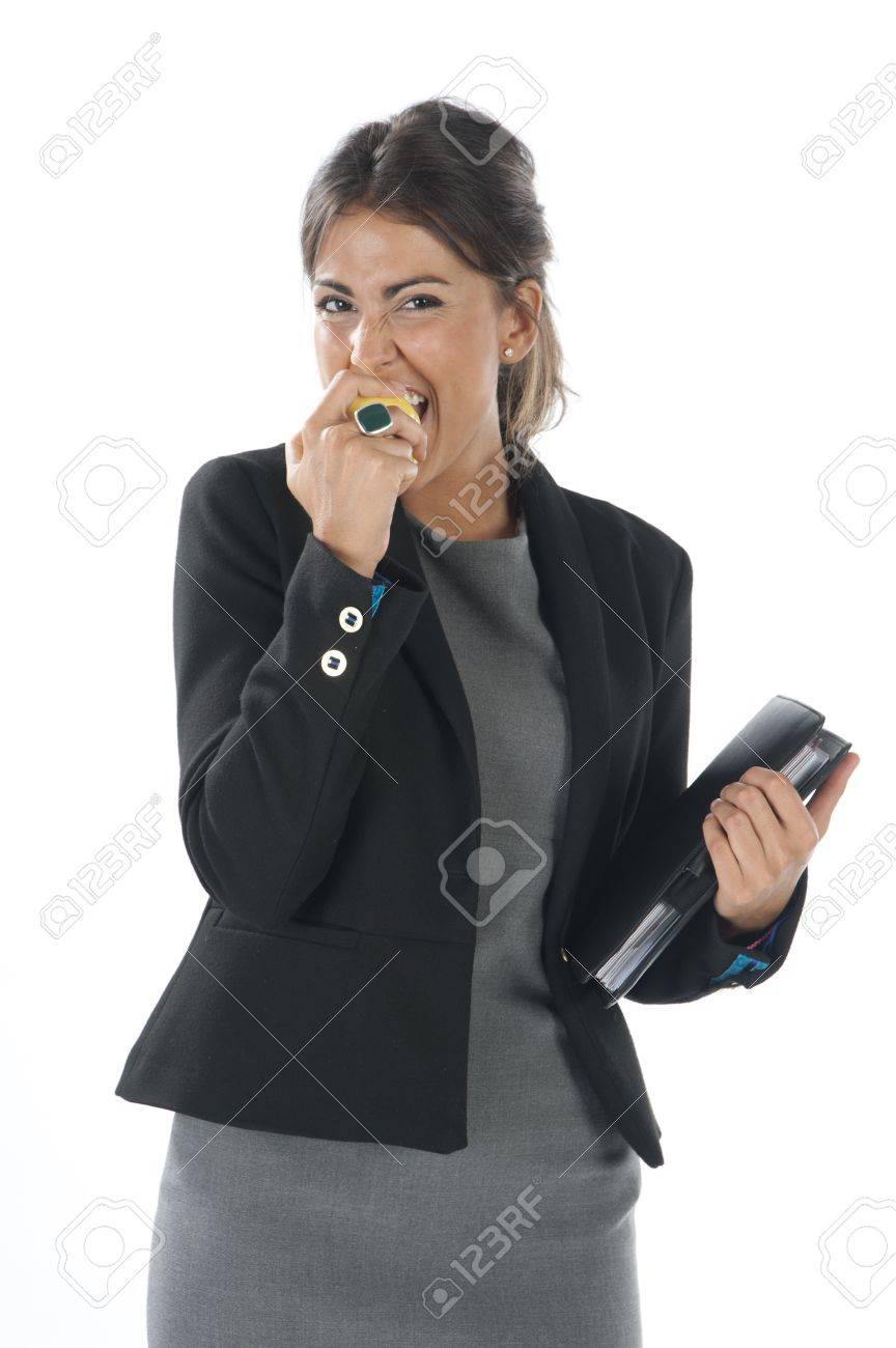 Waist up, young business executive woman, on white, biting an apple. Stock Photo - 14429875