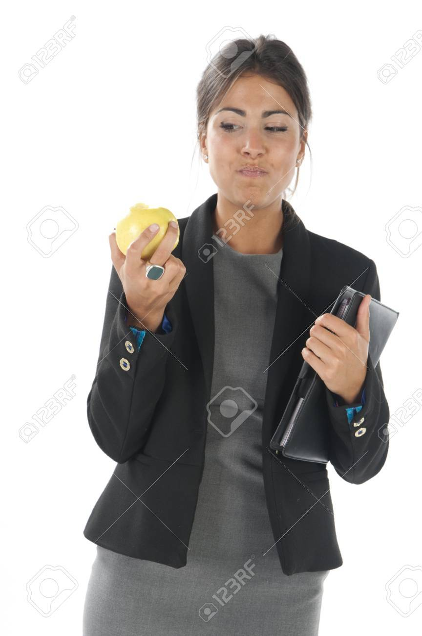 Waist up, healthy young business executive woman, on white, eating an apple. Stock Photo - 14429804