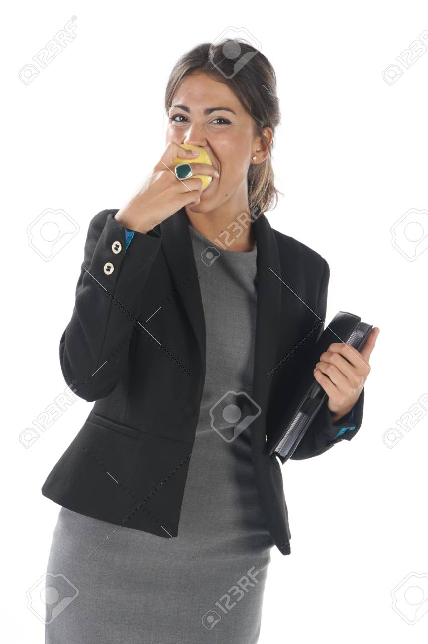 Waist up, healthy young business executive woman, on white, eating an apple. Stock Photo - 14429867