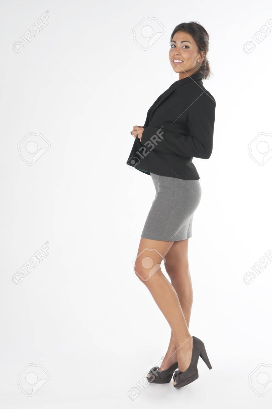 Young business executive woman, on white, bottoning her jacket. Stock Photo - 14429707