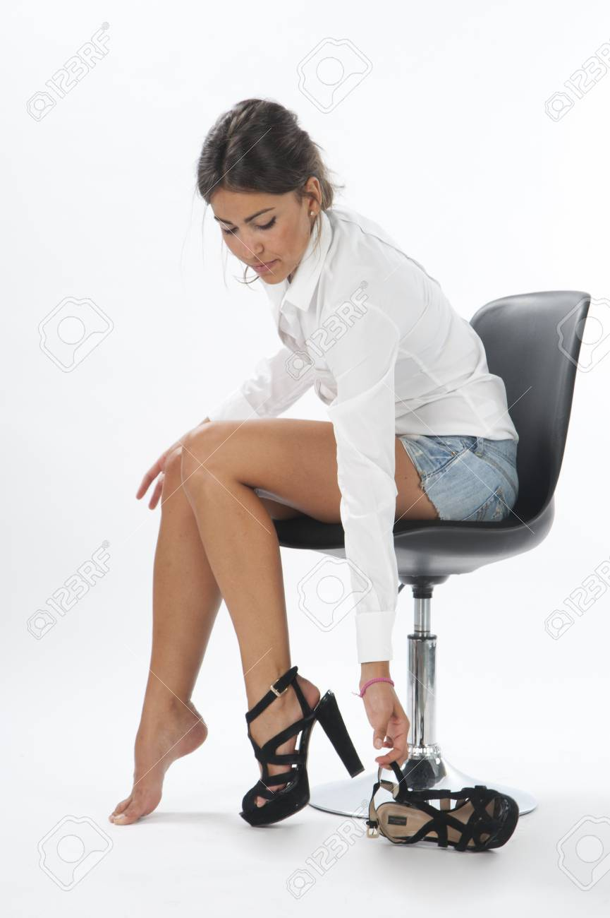 Young girl on white, trying on pair of shoes Stock Photo - 14429796