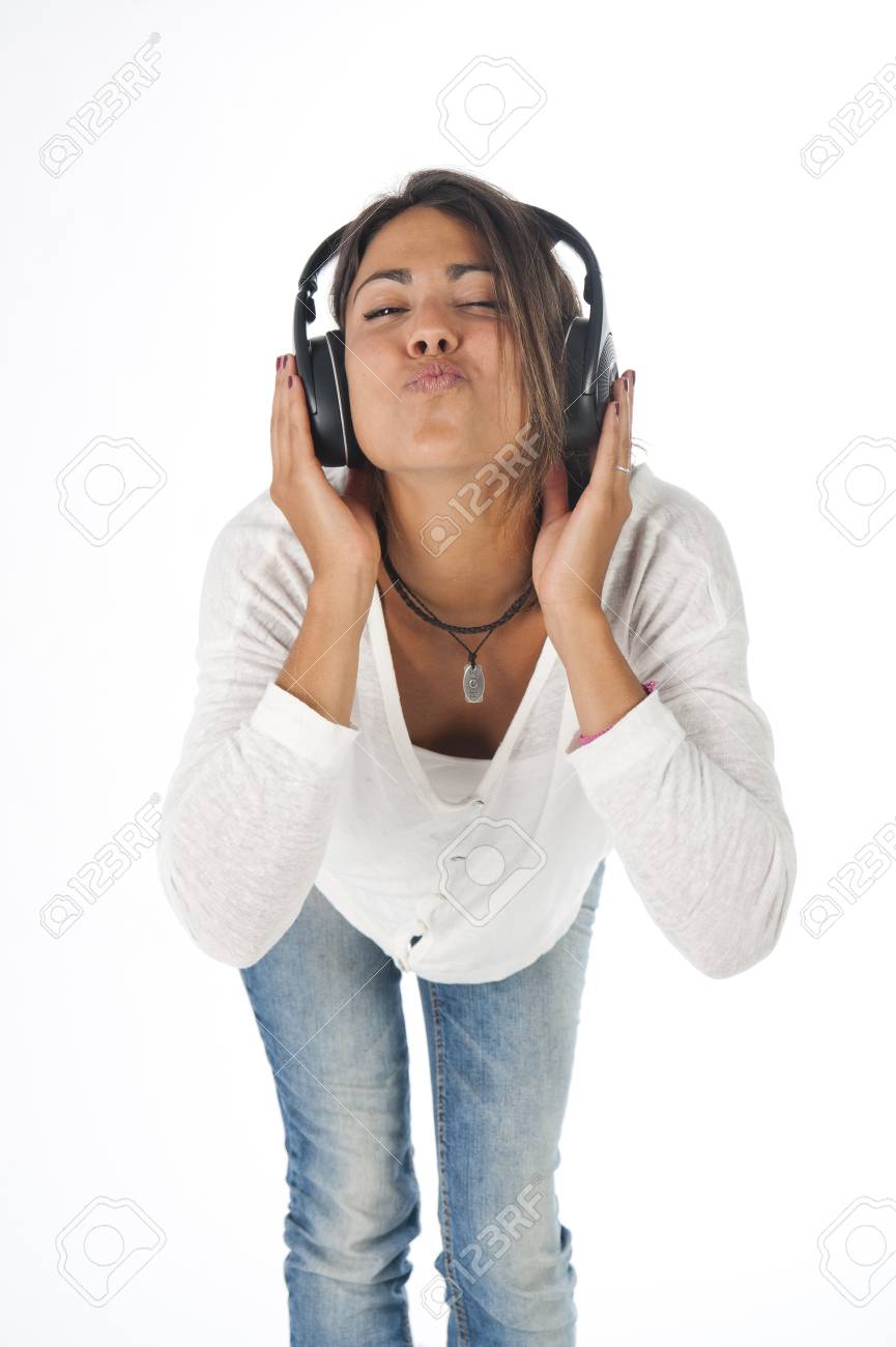 Three quarter length portrait of young girl with casual clothing, on white,  enjoying music with hands on headphones blowing a kiss Stock Photo - 14938085