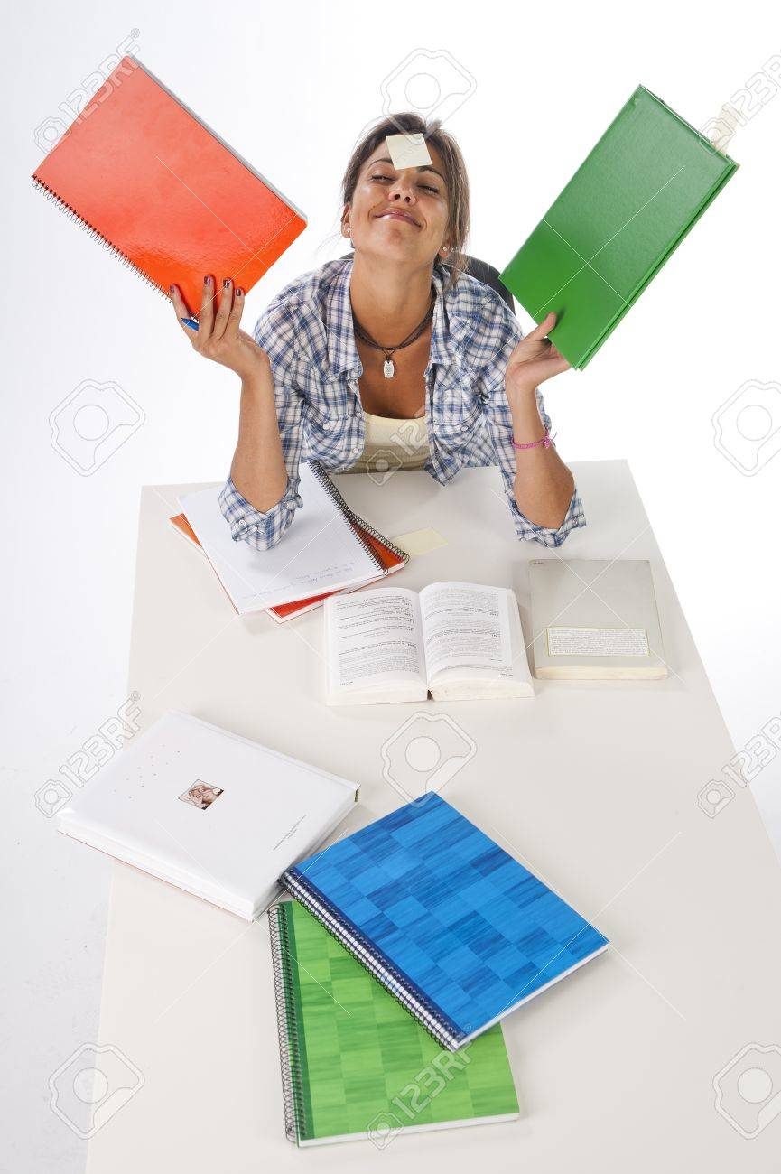 High Angle view of funny happy girl studying on table with books and notebooks on her hands Stock Photo - 14918945