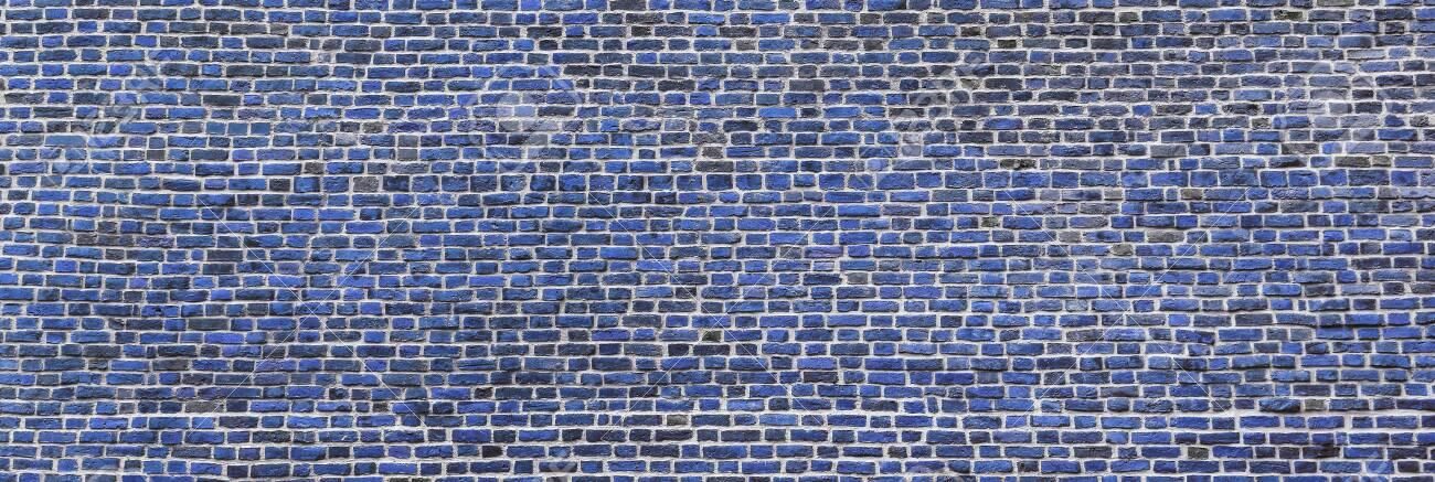 . Brick wall  wide panorama of navy blue masonry  Wall with small