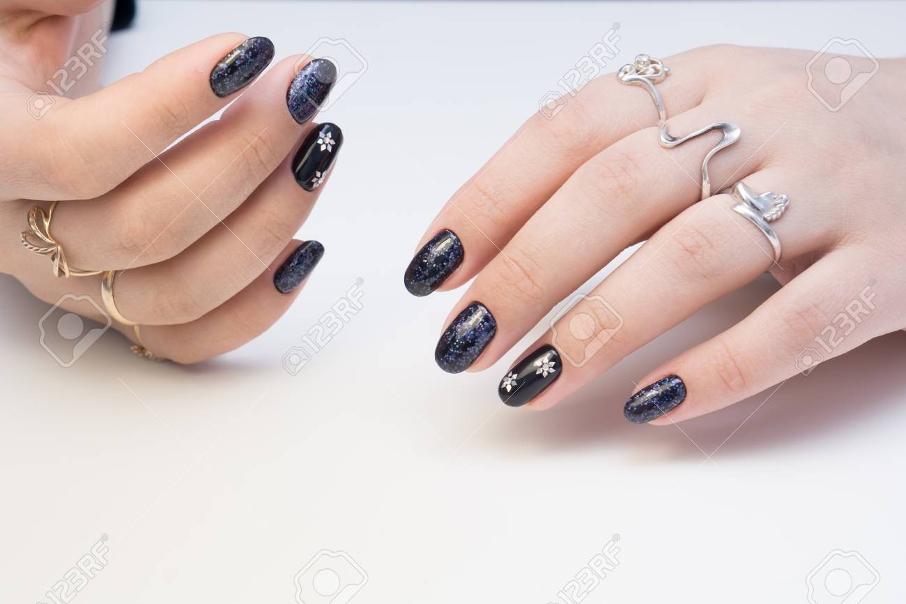 Amazing manicure and natural nails with gel polish. Attractive modern nail  art design. Stock - Amazing Manicure And Natural Nails With Gel Polish. Attractive
