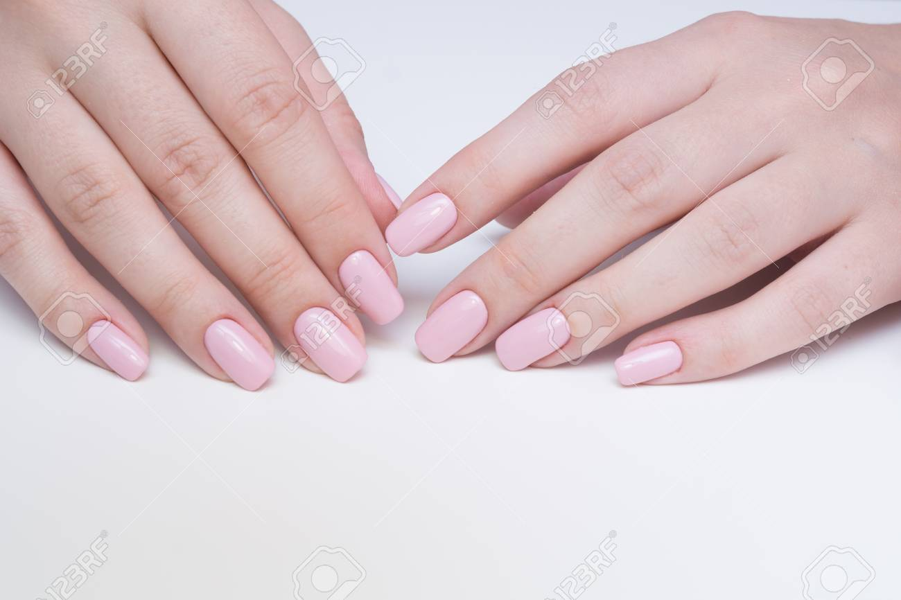 Amazing natural nails. Women's hands with clean manicure. Gel polish applied. - 92332589