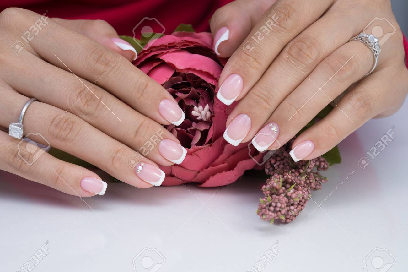 Natural nails with gel polish applied. Ideal manicure and women's hands. - 92334552
