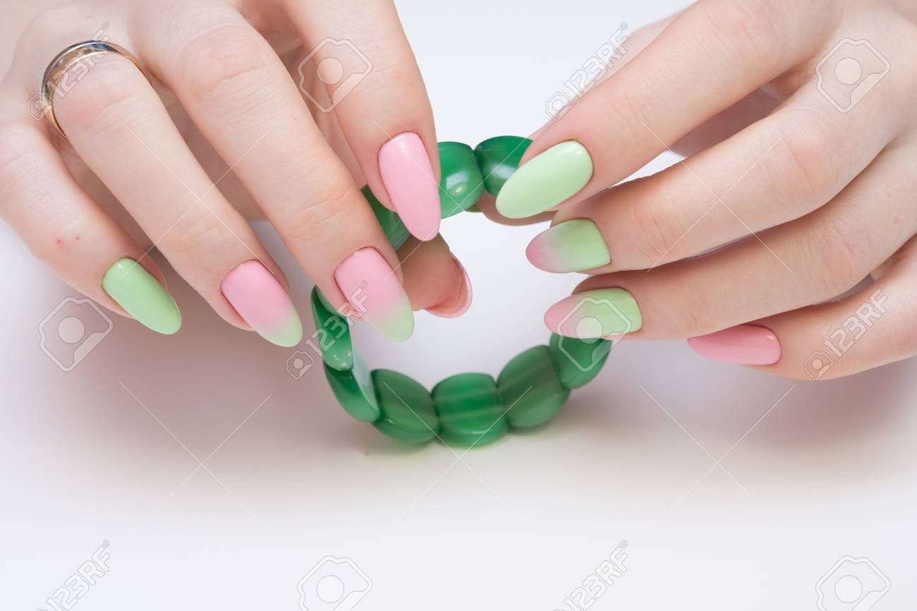 Natural nails with gel polish applied. Ideal manicure and women's hands. - 92332512