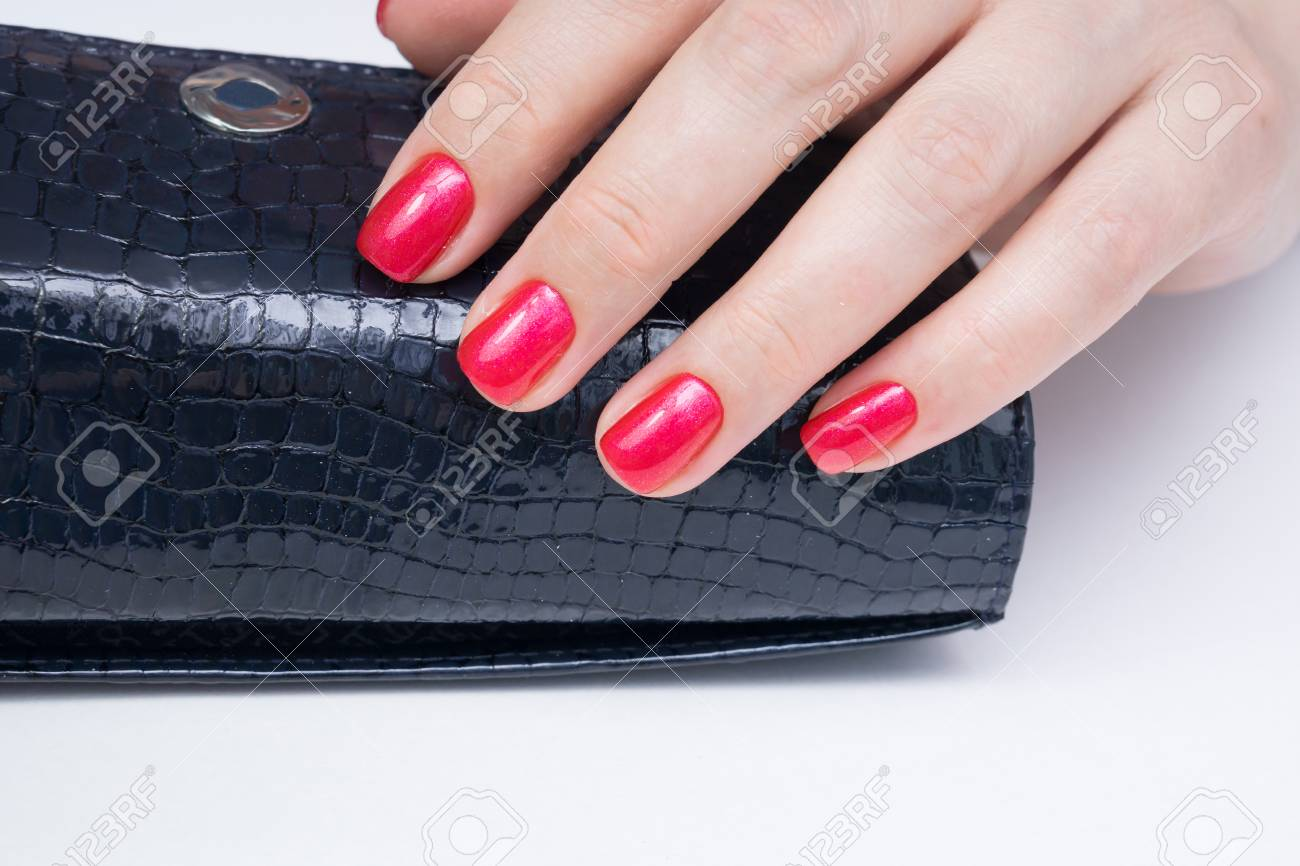 Natural nails with gel polish applied. Ideal manicure and women's hands. - 92401792