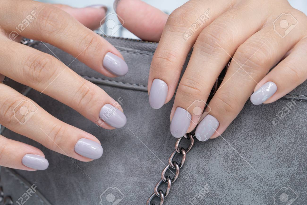 Natural nails with gel polish applied. Ideal manicure and women's hands. - 92334512