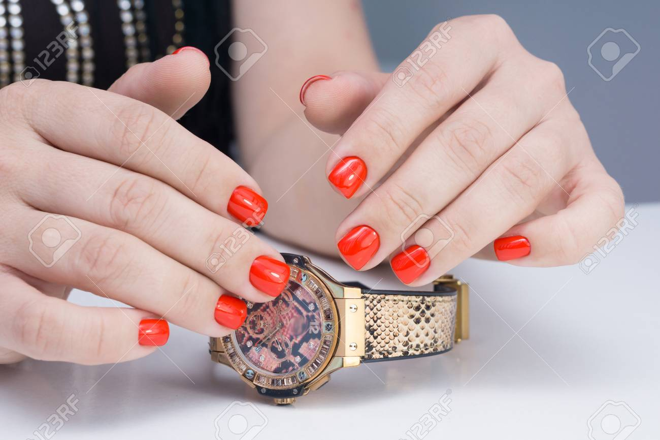 Natural nails with gel polish applied. Ideal manicure and women's hands. - 92337048
