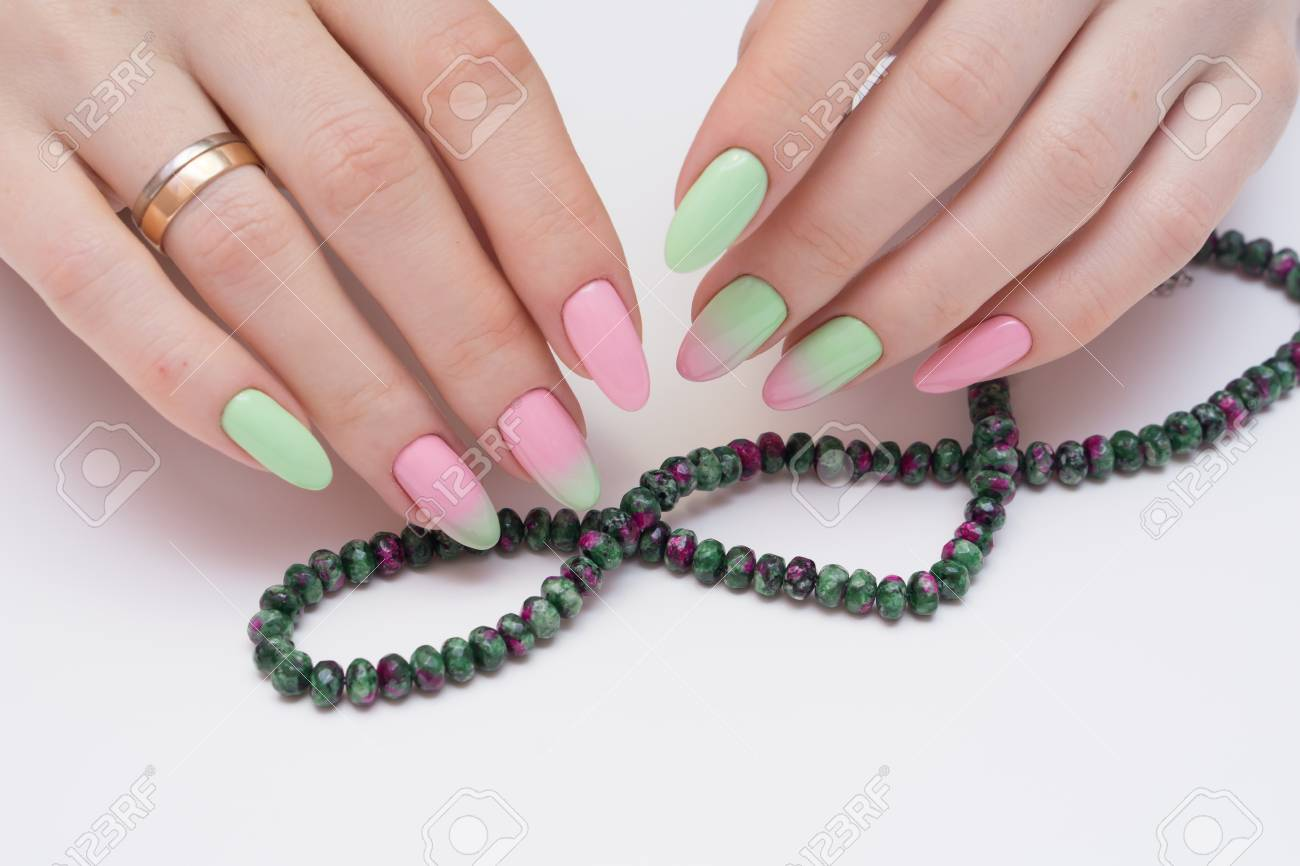 Natural nails with gel polish applied. Ideal manicure and women's hands. - 92401747