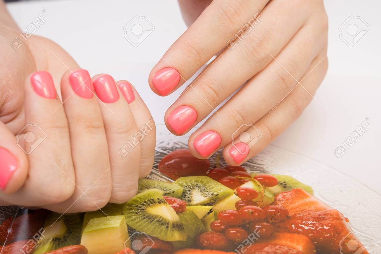Natural nails with gel polish applied. Ideal manicure and women's hands. - 92334672