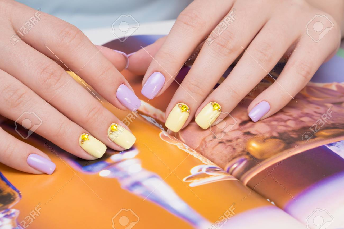 Natural nails with gel polish applied. Ideal manicure and women's hands. - 92334625