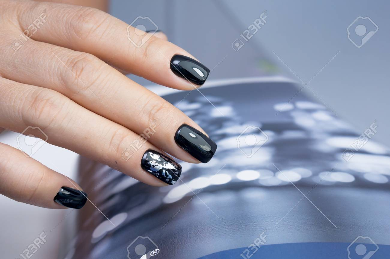 Beautiful natural nails and attractive manicure on women hands. - 92905786