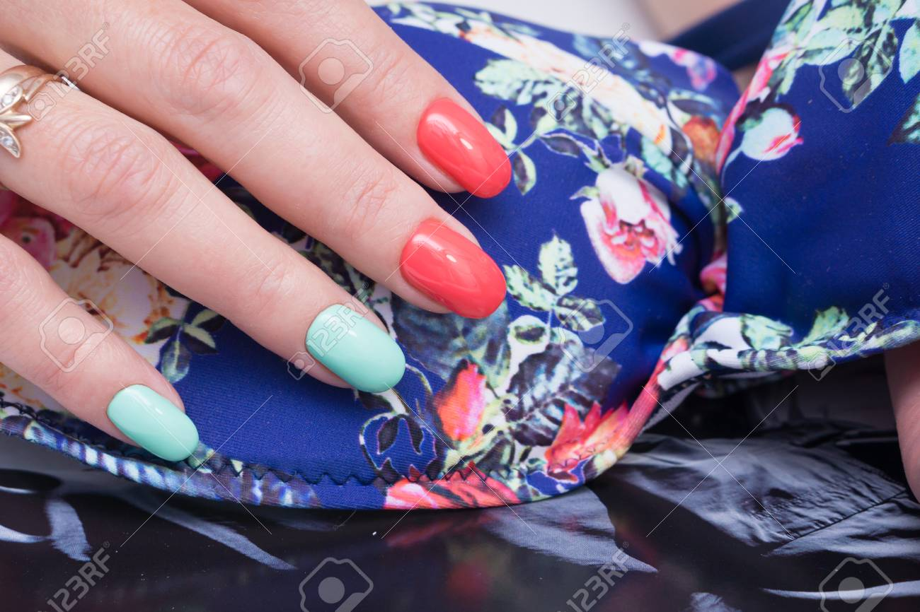 Beautiful natural nails and attractive manicure on women hands. - 92883082