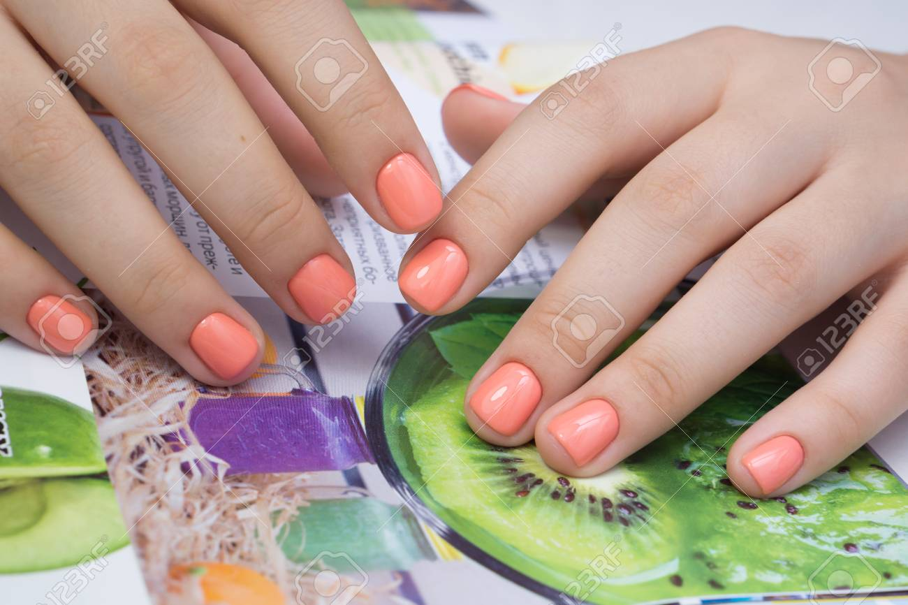 Beautiful natural nails and attractive manicure on women hands. - 92883938
