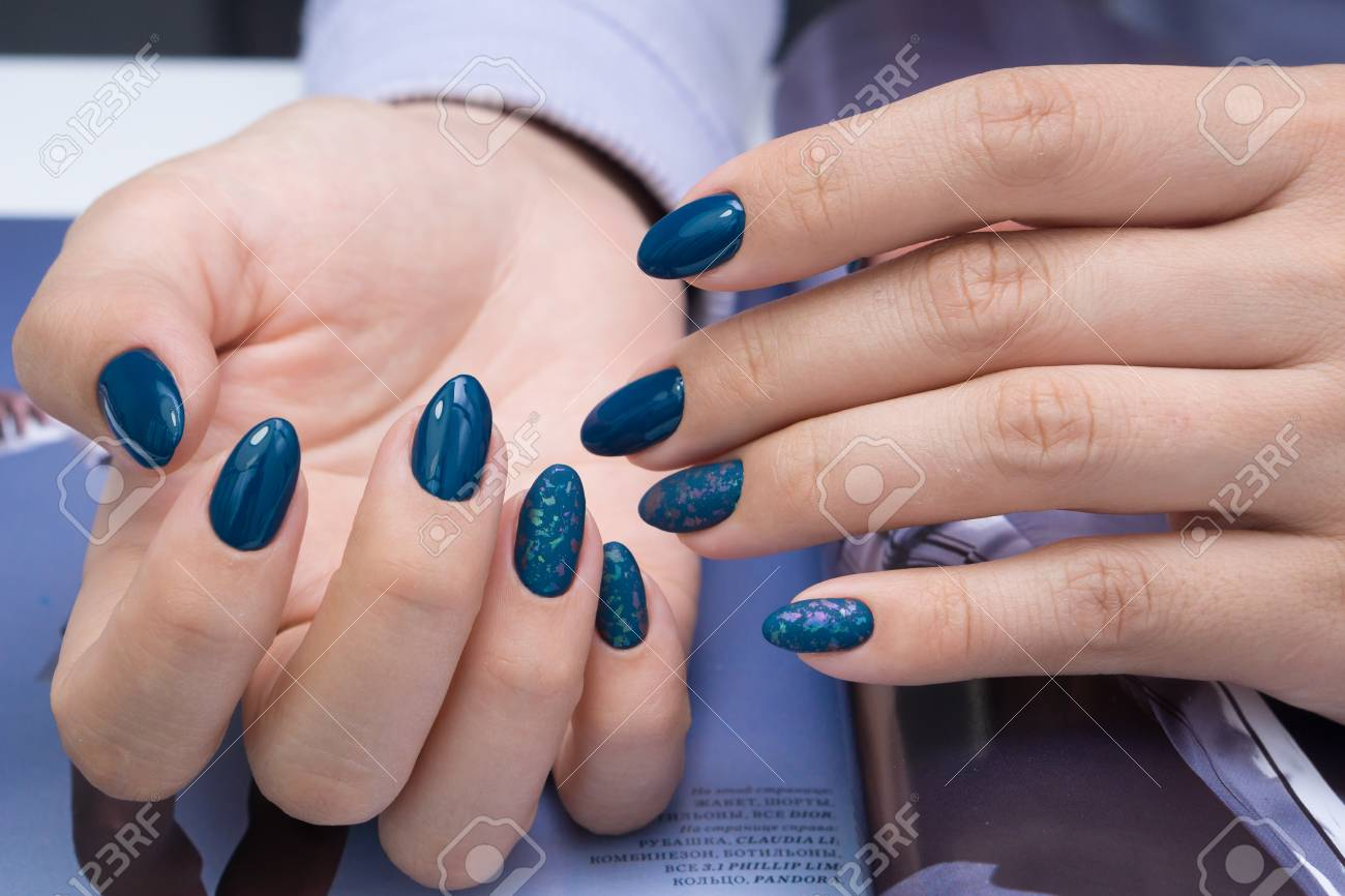 Beautiful natural nails and attractive manicure on women hands. - 92883939