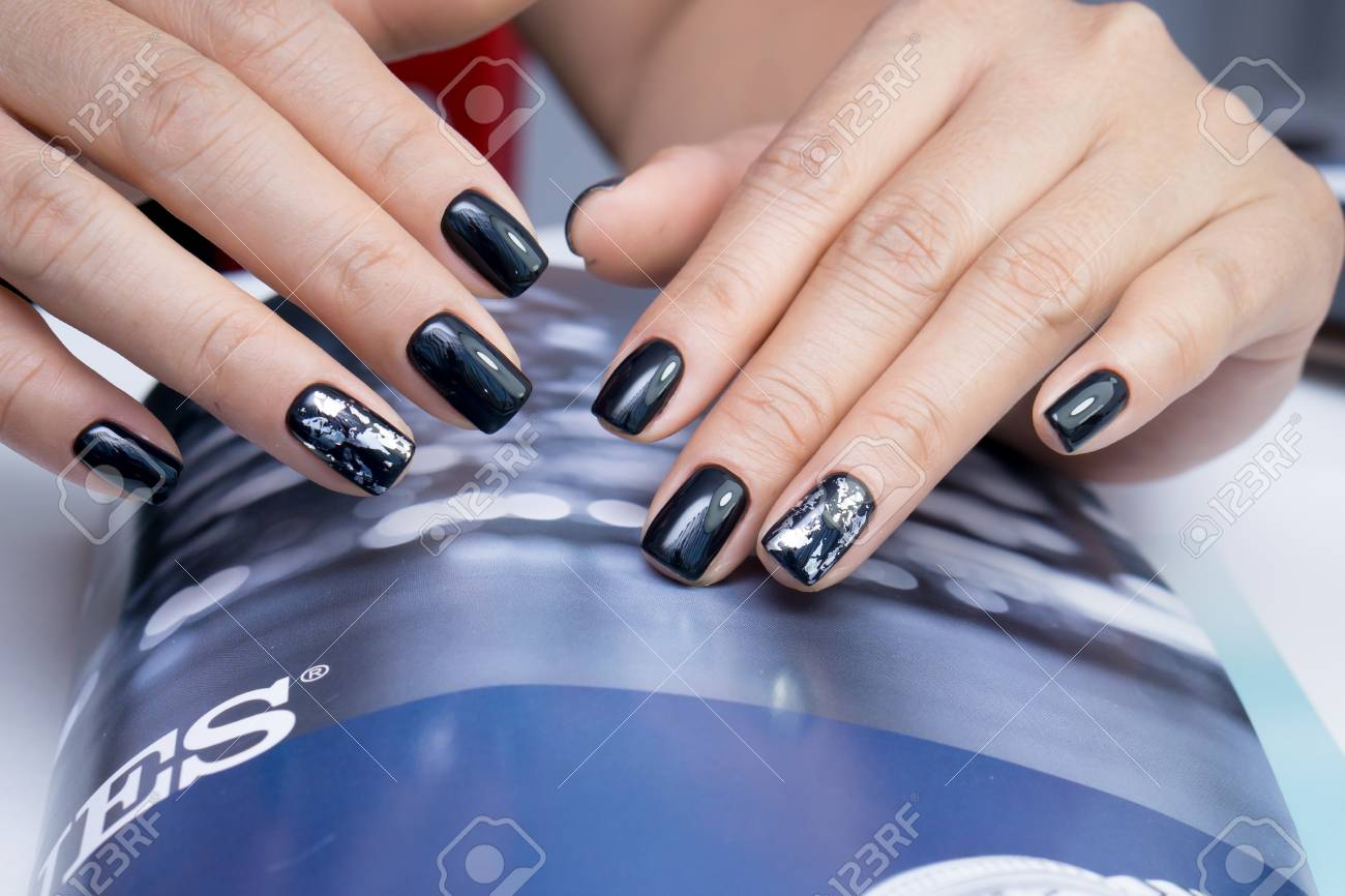 Beautiful natural nails and attractive manicure on women hands. - 92905793