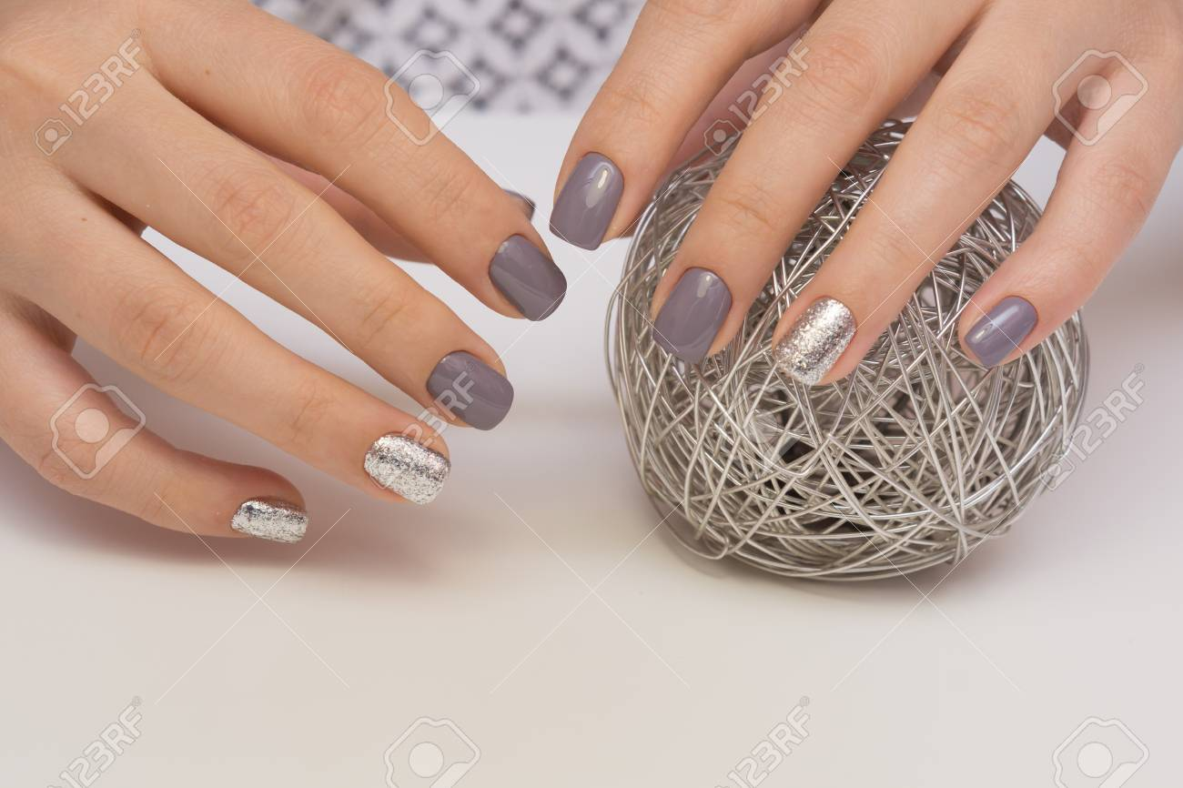 Beautiful natural nails and attractive manicure on women hands. - 92883941