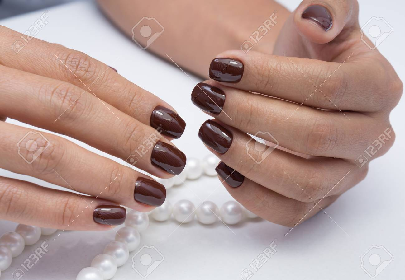 Beautiful natural nails and attractive manicure on women hands. - 92881684