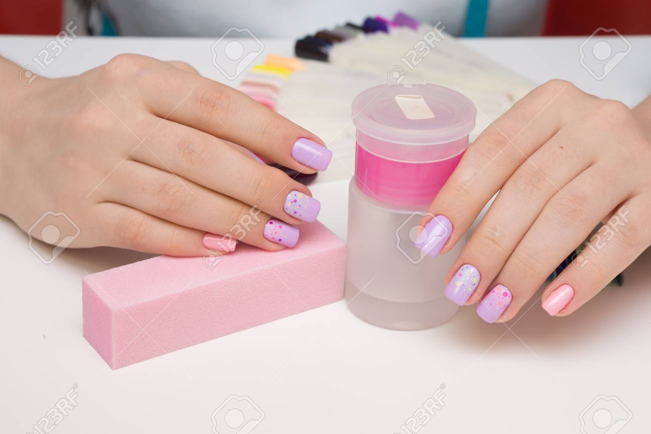Beautiful natural nails and attractive manicure on women hands. - 92883944