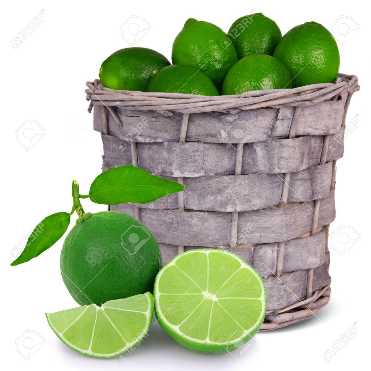 Basket with limes isolated on white Stock Photo - 13496239