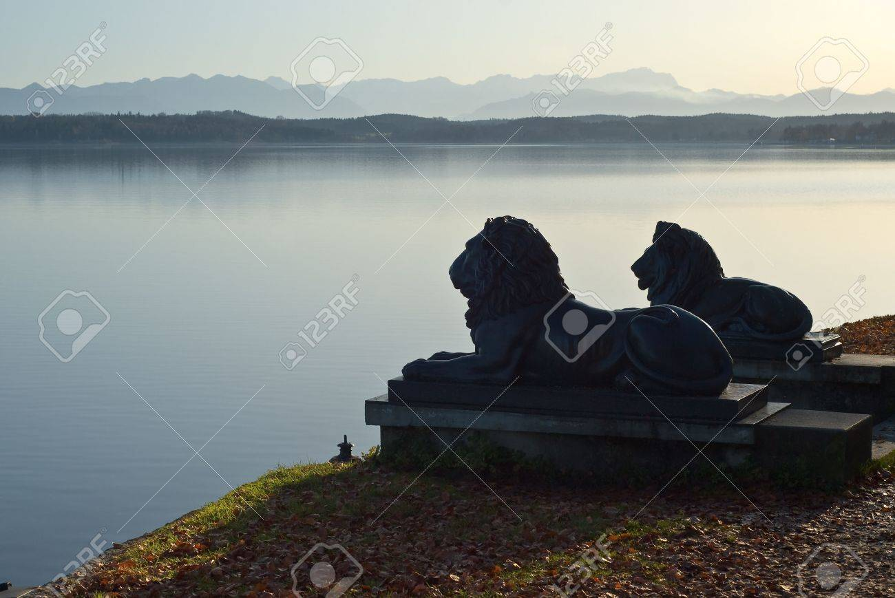 Lion Statues with German Alps and Lake Stock Photo - 6011744