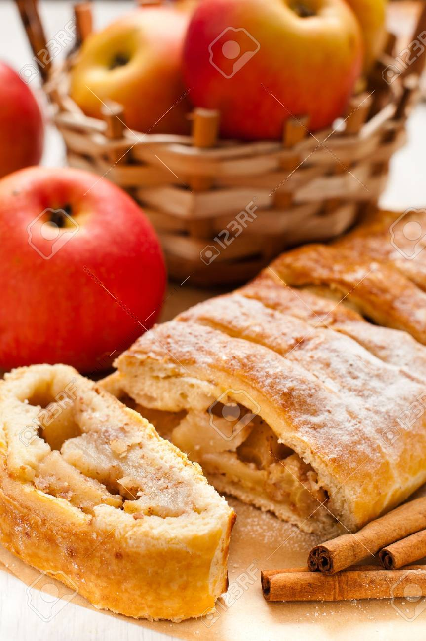 slice of an apple strudel on the table - 30977961