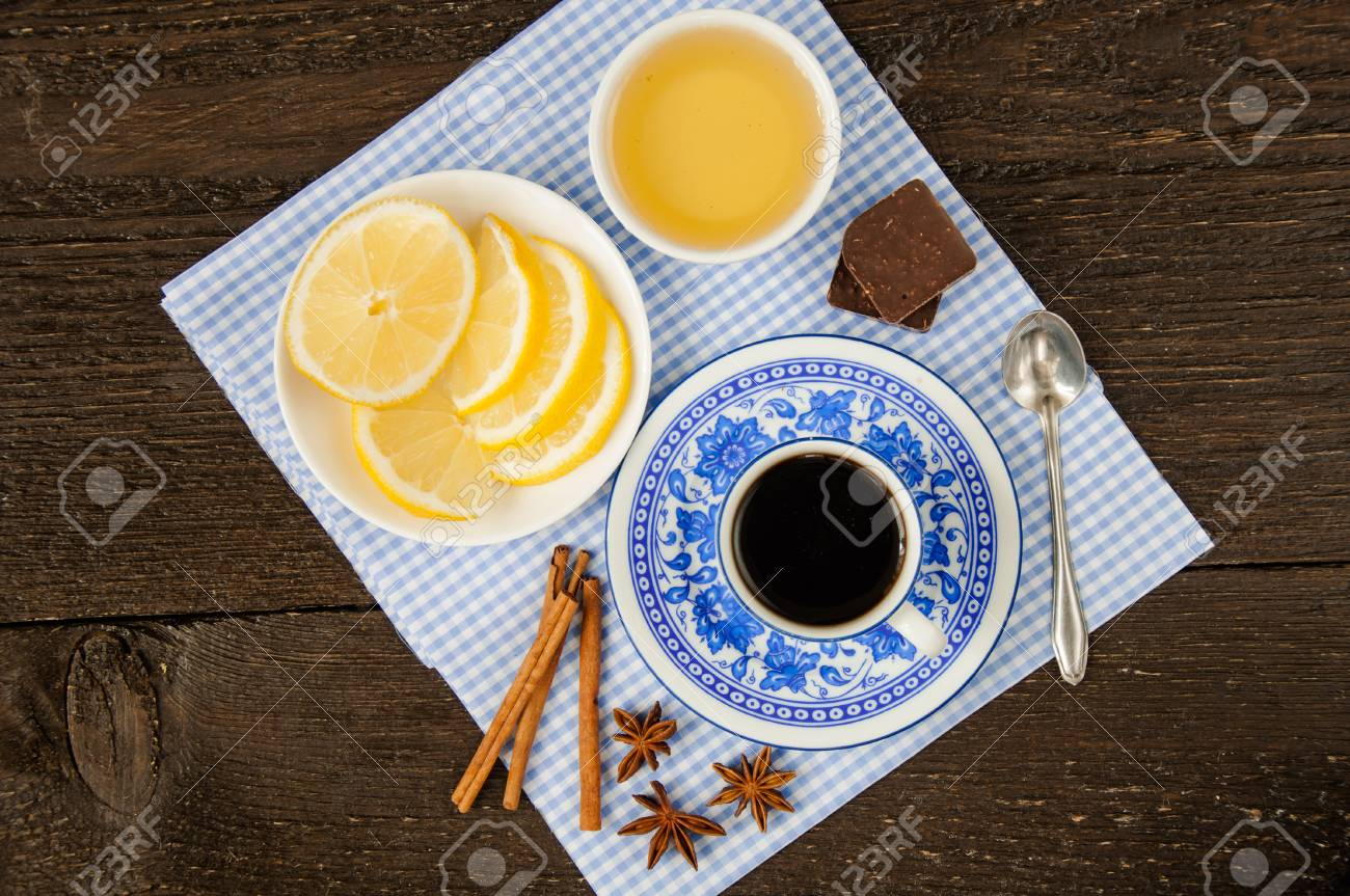 espresso in blue cup with lemon and honey on table - 34194747