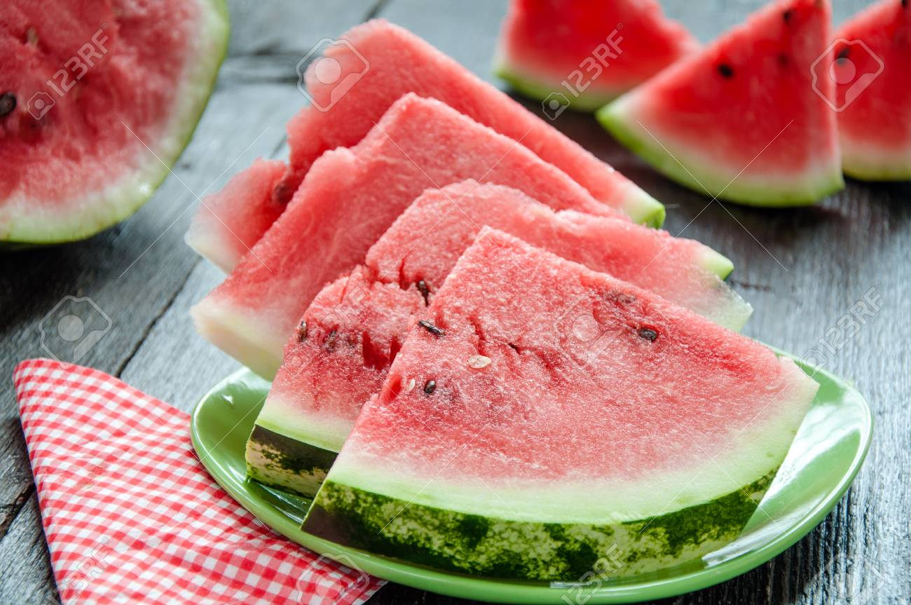 Ripe watermelons on table on wooden background - 34194757
