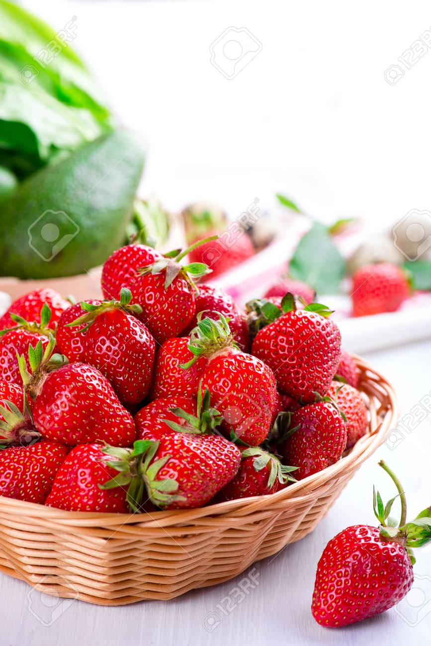 fresh strawberry in the basket on white wooden table - 58050339