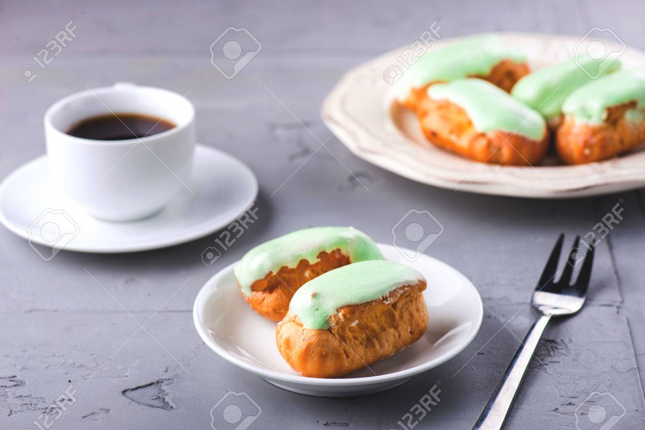 Breakfast with mint eclairs and coffee cup - 58050347