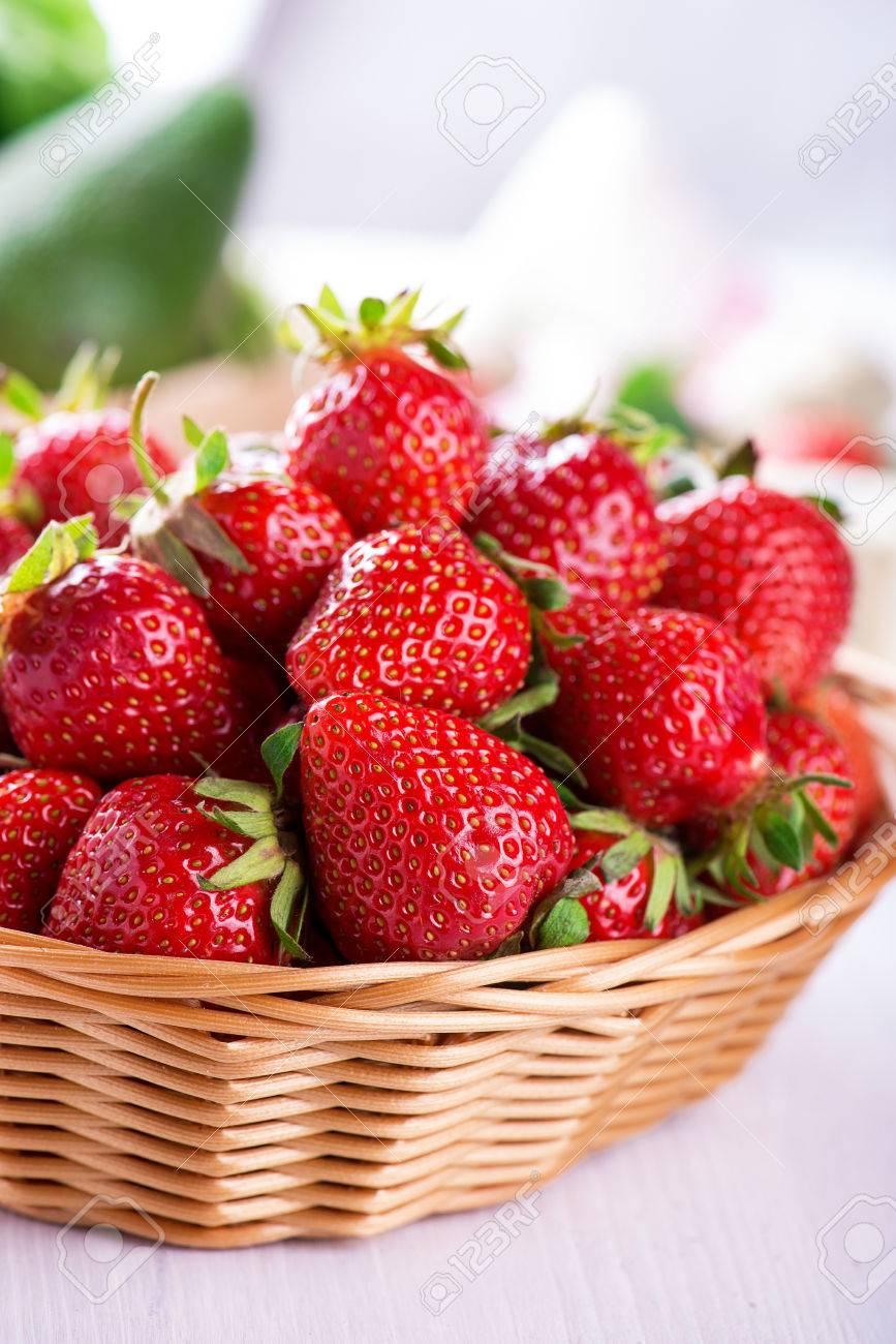 Fresh strawberries harvest in the basket - 58050357
