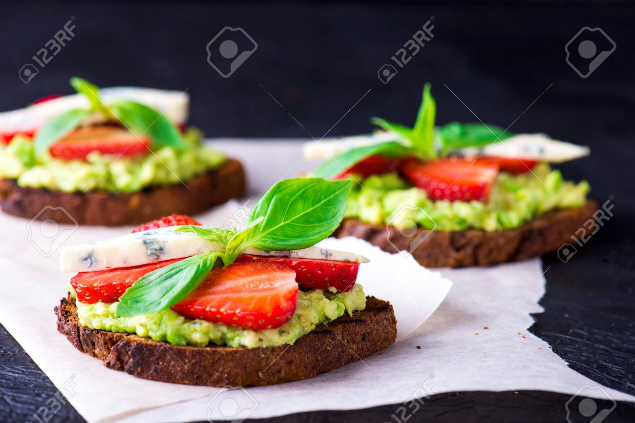 Sandwich with strawberry on white craft paper - 58050372