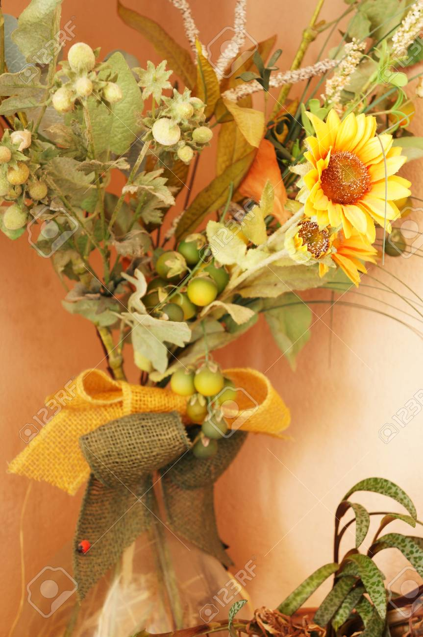 A glass pot with yellow sunflowers and other decorative plants Stock Photo - 14097134