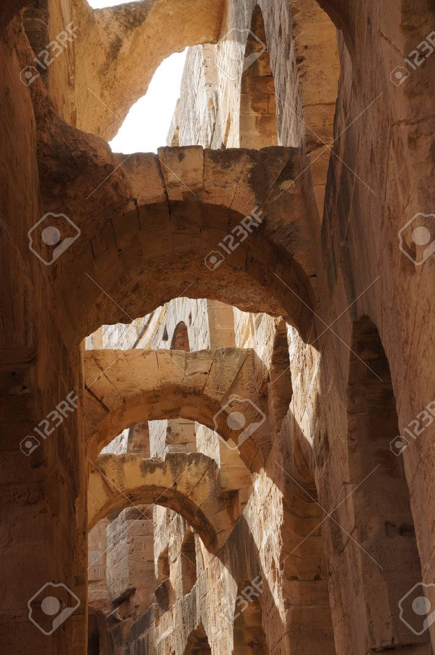 Roman ruins of the amphitheater in El Djem with stone arches Stock Photo - 15046235