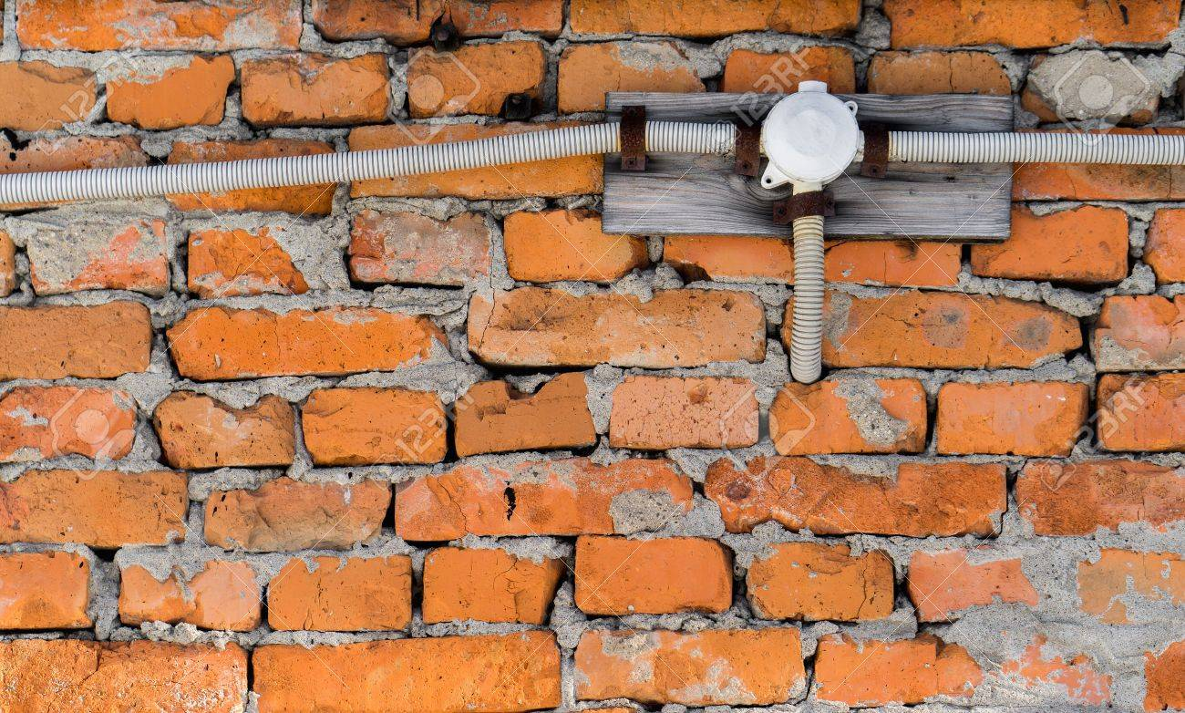 electrical wiring on a brick wall stock photo picture and royalty rh 123rf com Wall Electrical Wiring Wall Switch Wiring
