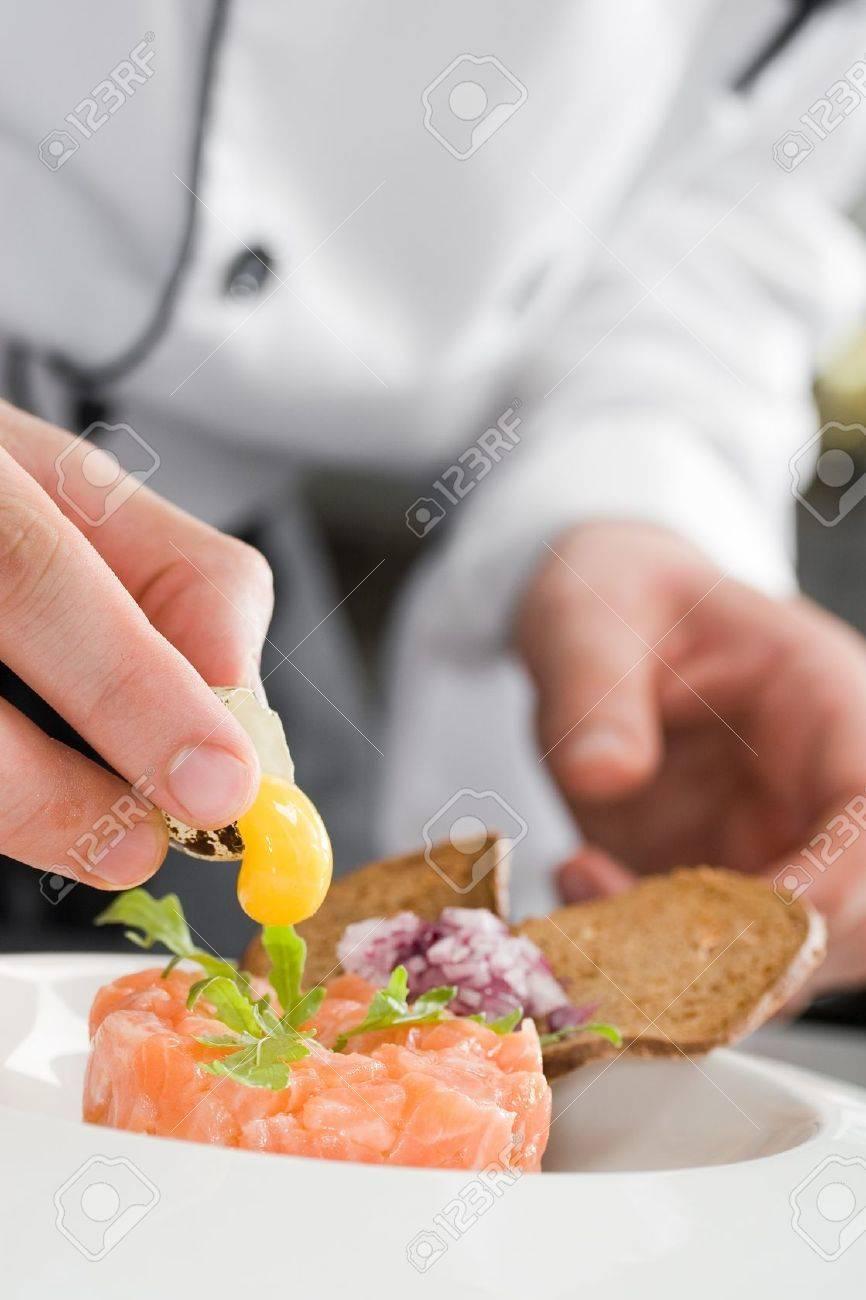 Chef prepearing salmon salad Stock Photo - 10173535