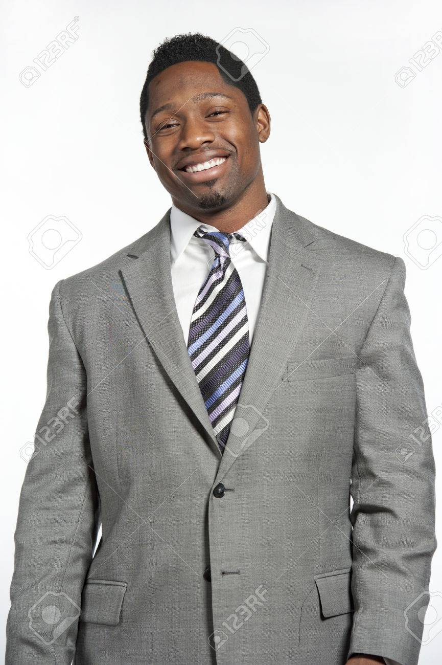 69595850f93 Attractive African American male model wearing a gray suit with a modern tie  posing in a